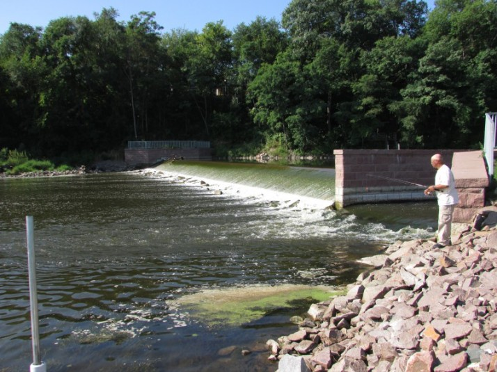 Montello Dam and fisherman in Montello