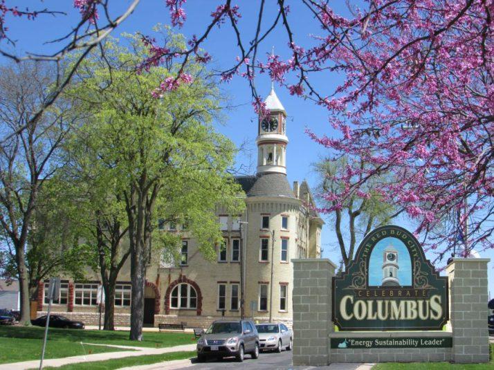 Redbud Tree and City Hall and sign