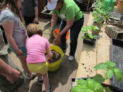 Kids potting a plant