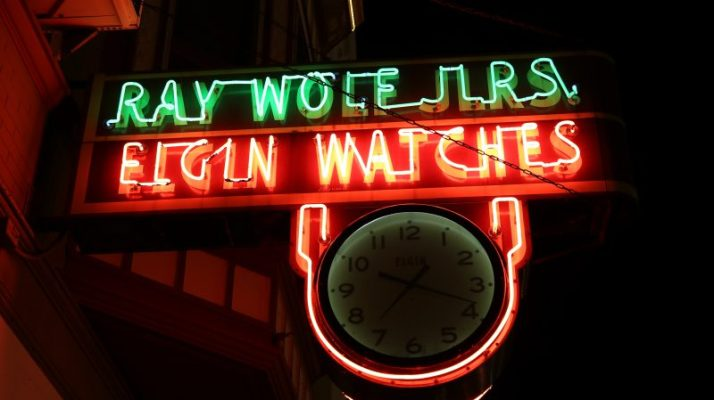 Elgin Watch neon sign at night