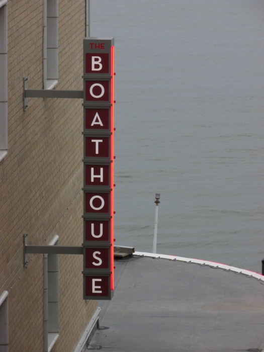 The Boathouse sign lit summer