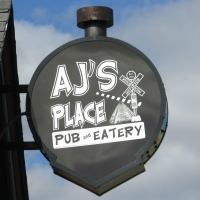 AJ's Pub and Eatery sign