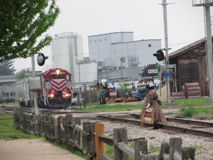 Lady Crossing Railroad Track in Milton