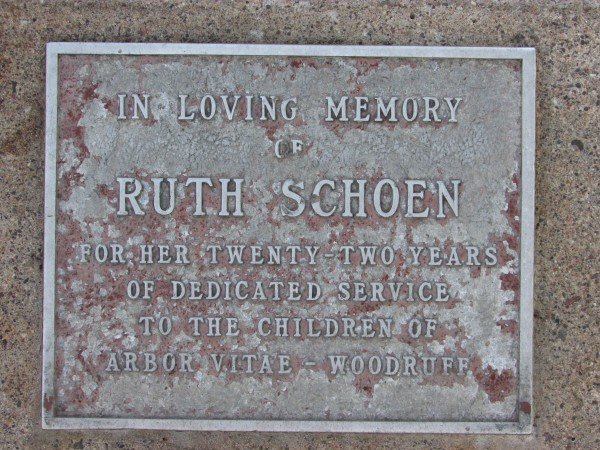 Ruth Schoen flagpole plaque in Woodruff