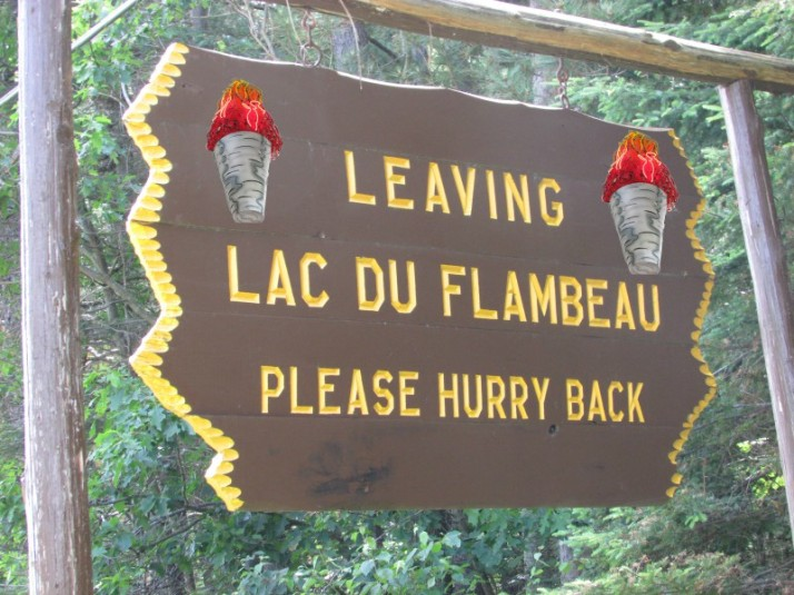 Leaving Lac du Flambeau sign torches