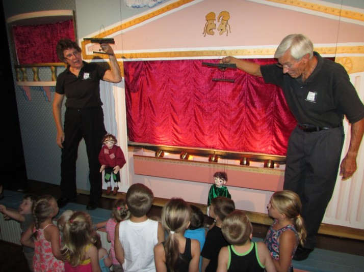 Chuck and Sandy show the puppets in Hazel Green