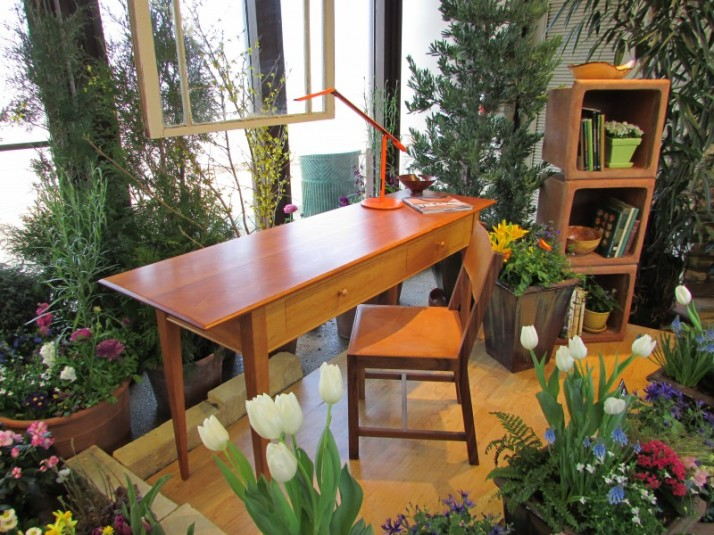 Desk and bookcase at flower show