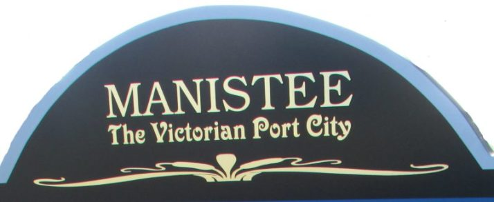 Manistee The Victorian Port City sign
