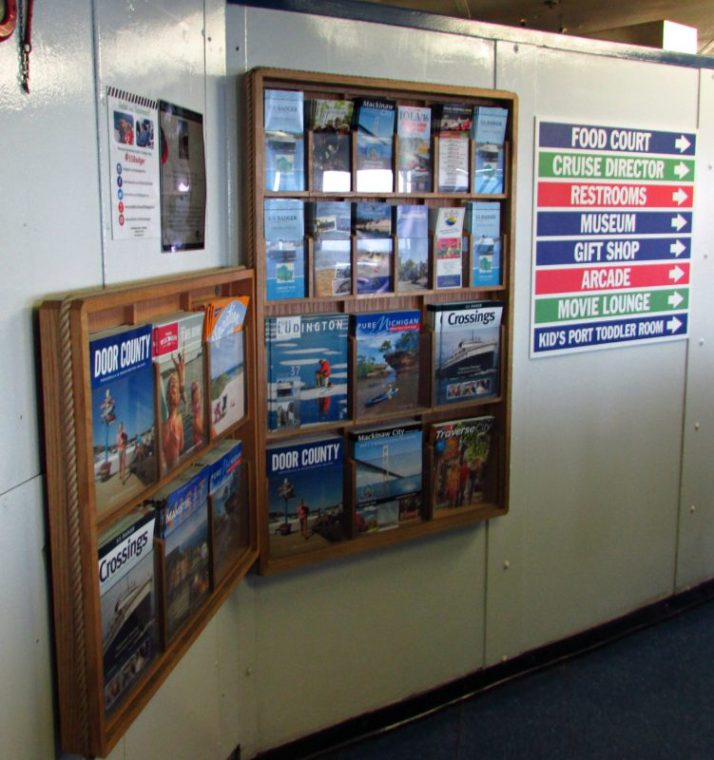Publication Rack and ship amenity sign on Badger