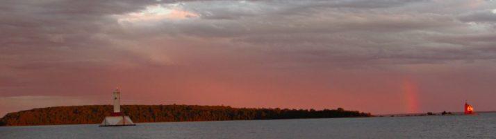 Round Island and rainbow at sunset